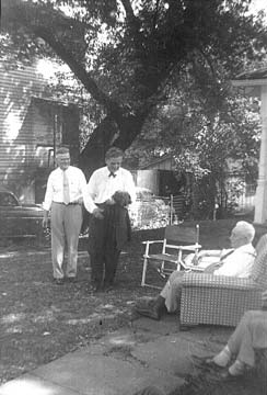Mr. Fischer, Gov. Frank Lausche and sitting, W.W. Taylor. Taylor High School is named after Mr. Taylor.